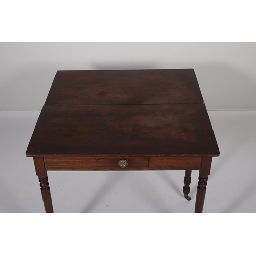 17 - A GEORGIAN MAHOGANY FOLD OVER SUPPER TABLE the rectangular hinged top with frieze drawer on baluster...
