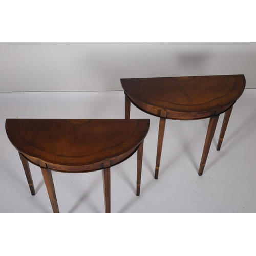 18 - A PAIR OF SHERATON DESIGN MAHOGANY SIDE TABLES each of serpentine outline the shaped top above a mou...