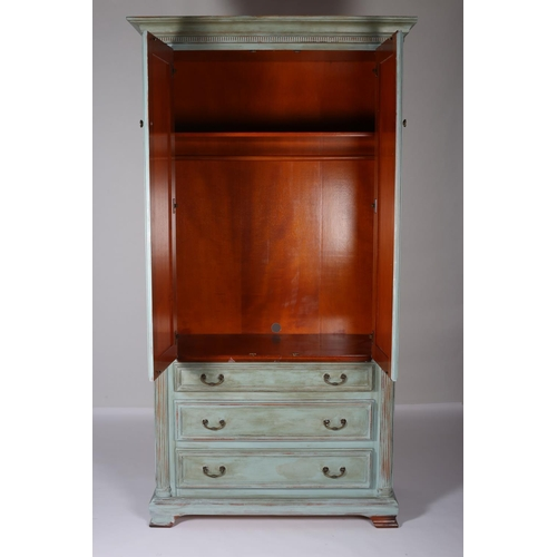 2 - A CHERRYWOOD BLUE PAINTED WARDROBE the outswept moulded cornice above a pair of panelled doors conta...