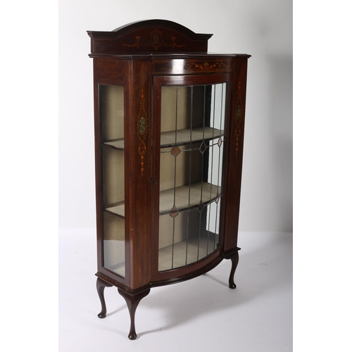 20 - AN EDWARDIAN MAHOGANY INLAID AND POLYCHROME DISPLAY CABINET of rectangular bowed outline lead glass ...