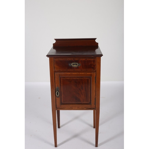 28 - AN EDWARDIAN MAHOGANY AND SATINWOOD INLAID CUPBOARD the rectangular top with frieze drawer and panel...
