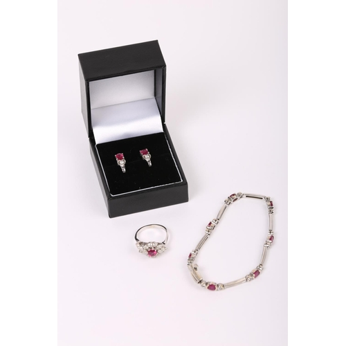 AN 18CT WHITE GOLD RUBY AND DIAMOND SUITE comprising earrings bracelet and dress ring Size L