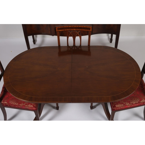 31 - A SIX PIECE MAHOGANY DINING ROOM SUITE comprising four dining chairs to include an elbow chair each ...