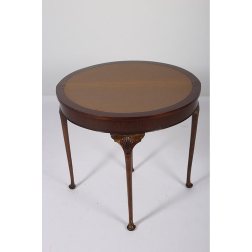 34 - A GEORGIAN DESIGN MAHOGANY CROSS BANDED FOLD OVER CARD TABLE of demilune outline with baize lined in...