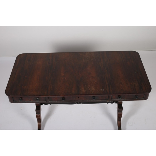 37 - A RECENCY ROSEWOOD LIBRARY TABLE the rectangular top above three frieze drawers on standard end supp...