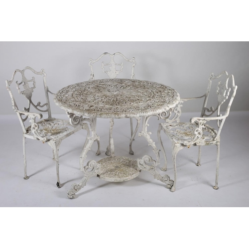 41 - A WHITE PAINTED CAST ALUMINIUM FIVE PIECE PATIO SUITE comprising four chairs together with a circula...