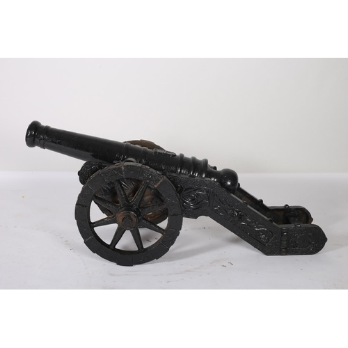 42 - A PAIR OF CAST IRON CANNONS of typical form 58cm (h) x 48cm (w) x146cm (d)