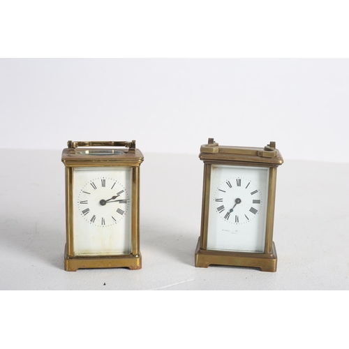 56 - TWO FRENCH BRASS CARRIAGE CLOCKS with enamel dials and Roman numerals together with A CUT GLASS SHIP...