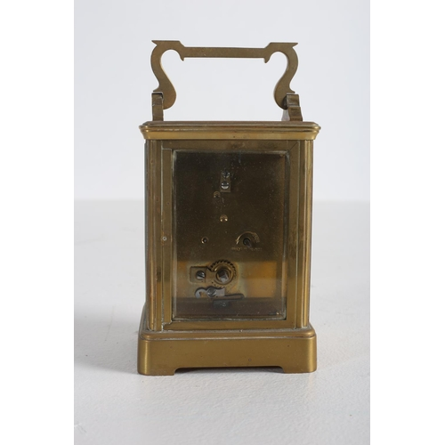 57 - A FRENCH BRASS CARRIAGE CLOCK with enamel dial and Roman numerals