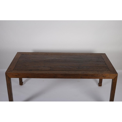 8 - A SIMULATED HARDWOOD DINING TABLE the rectangular planked top with glazed panel on square tapering l...