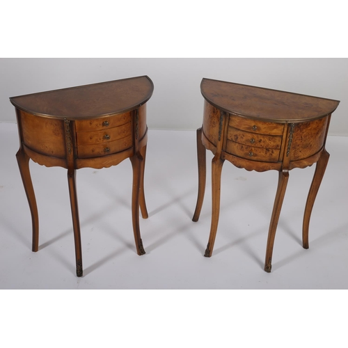 9 - A PAIR OF CONTINENTAL WALNUT AND GILT BRASS MOUNTED SIDE TABLES each of demilune outline with three ...