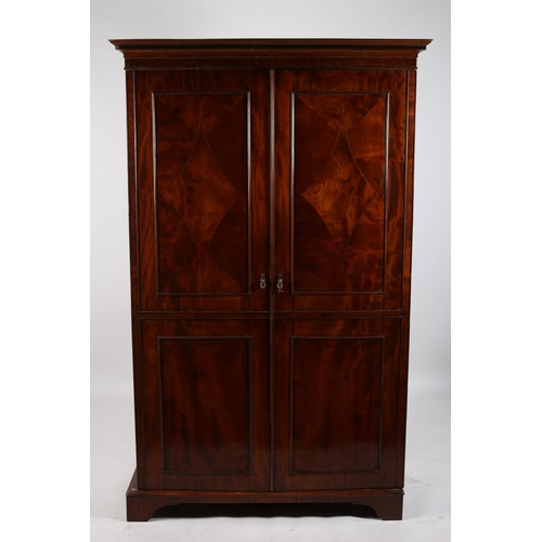 13 - A 19TH CENTURY MAHOGANY TWO DOOR WARDROBE the dentil moulded cornice above a pair of inlaid panelled...