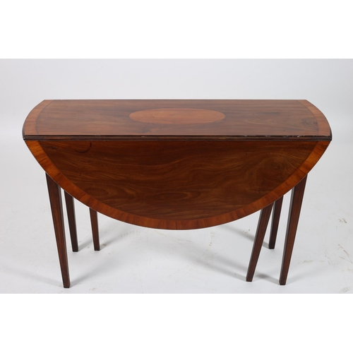 14 - A SHERATON DESIGN MAHOGANY AND SATINWOOD CROSS BANDED DROP LEAF TABLE the oval hinged top on square ...