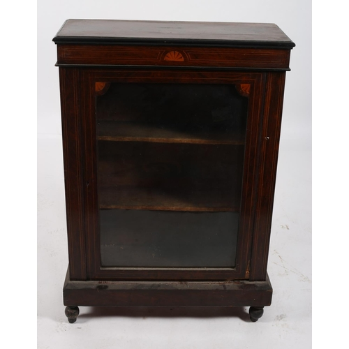 17 - A 19TH CENTURY ROSEWOOD AND SATINWOOD INLAID PIER CABINET of rectangular outline the shaped top abov...