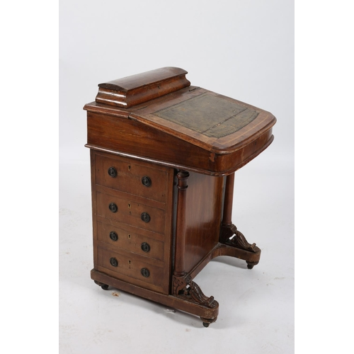 18 - A 19TH CENTURY MAHOGANY DAVENPORT the superstructure with hinged compartment above a tooled leather ...