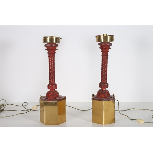 23 - A PAIR OF RED LACQUERED AND BRASS TABLE LAMPS each with a spiral twist column above an octagonal bra...