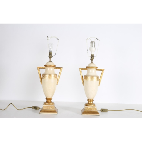 25 - A PAIR OF CREAM AND GILT TABLE LAMPS each in the form of a Greek urn 69cm (h)
