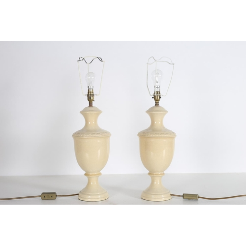 28 - A PAIR OF GLAZED CHINA TABLE LAMPS each of baluster form with egg and dart decoration 63cm (h)