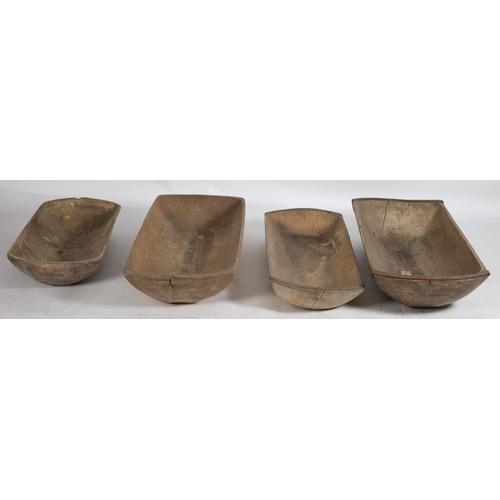 35 - FOUR VINTAGE PINE AND STEEL BOUND GRADUATED TROUGHS larger 113cm x 52cm smaller 96cm x 45cm