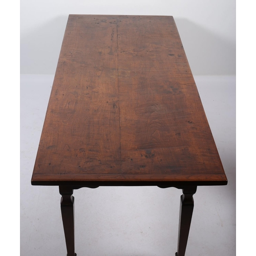 37 - AN OAK DINING TABLE of rectangular outline raised on square tapering legs with block feet 77cm (h) x...