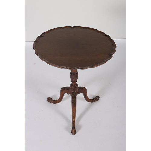 43 - A GEORGIAN DESIGN MAHOGANY SNAP TOP TABLE the pie crust top above a carved tripod support with claw ...