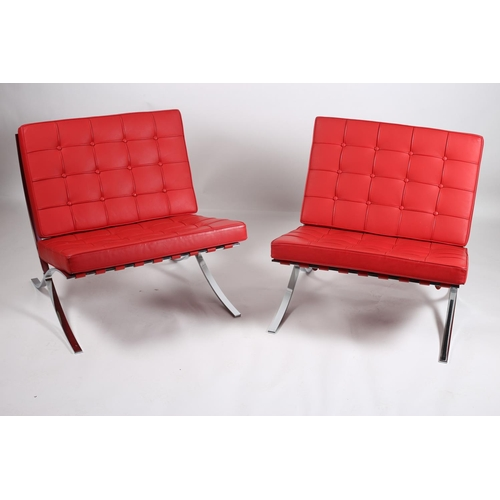 5 - A PAIR OF DESIGNER CHROME AND RED HIDE UPHOLSTERED CHAIRS each with a rectangular button upholstered...
