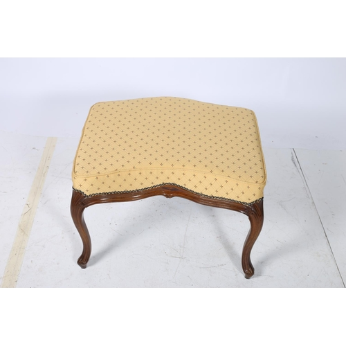 50 - A CONTINENTAL WALNUT AND UPHOLSTERED STOOL the serpentine seat above a moulded apron on cabriole leg...