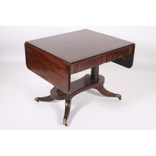 52 - A GEORGIAN MAHOGANY AND ROSEWOOD CROSS BANDED SOFA TABLE the rectangular hinged top above two frieze...