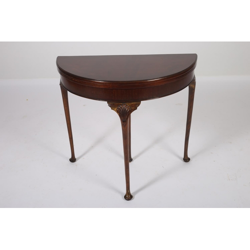 56 - A GEORGIAN DESIGN MAHOGANY CROSS BANDED FOLD OVER CARD TABLE of demilune outline with baize lined in...