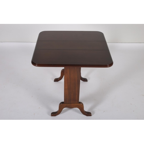 57 - A MAHOGANY SUTHERLAND TABLE the rectangular hinged top on standard end supports with splayed legs jo...