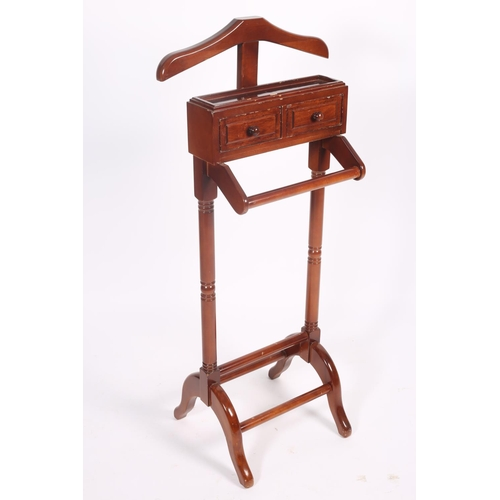 59 - A MAHOGANY VALET of typical form 129cm (h) x 44cm (w) x 42cm (d)