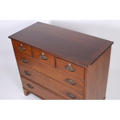 9 - A GEORGIAN MAHOGANY CHEST the rectangular top with satinwood string inlay above three short and thre...