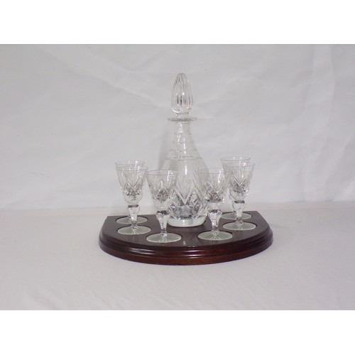3 - complete decanter set on a wooden base...
