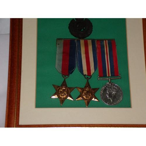 56 - WW2 war medals in a frame...