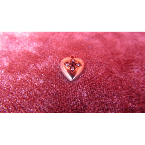 12 - A STAMPED GOLD CHARM HEART WITH STONES...