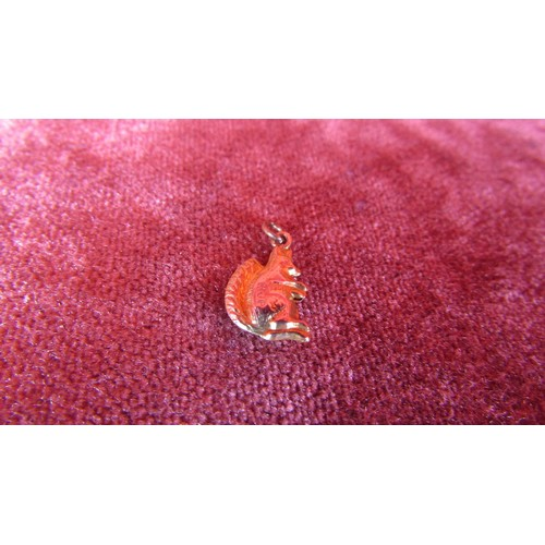 41 - A STAMPED GOLD CHARM SQUIRREL...