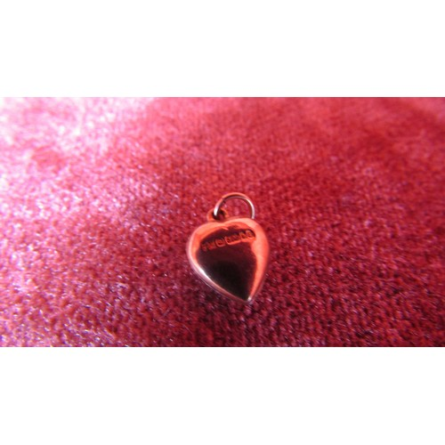 33 - A STAMPED GOLD HEART  CHARM...