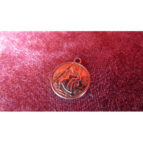 4 - A ST CHRISTOPHER GOLD CHARM...