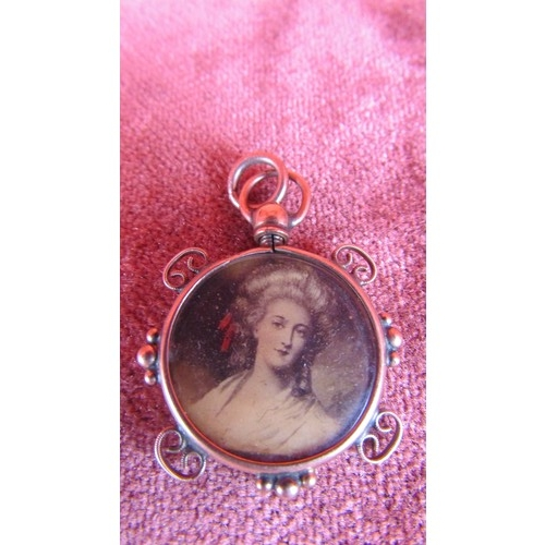 19 - 9CT GOLD TWO SIDED PENDANT WITH PICTURES...