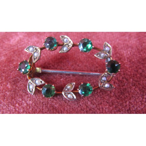 57 - 9CT GOLD BROOCH WITH GREEN STONES...