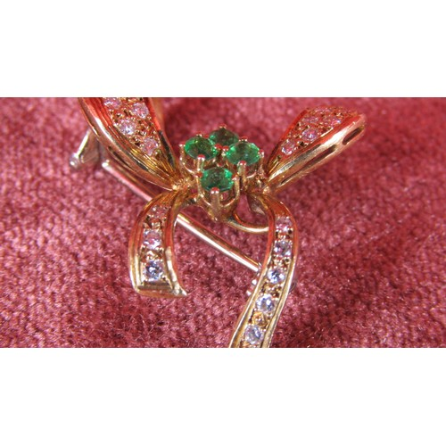 7 - 18 CARAT GOLD BROOCH WITH EMERALDS AND 1 CARAT OF DIAMONDS