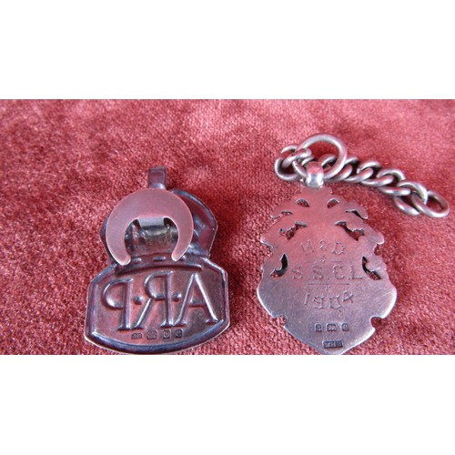20 - H&D S.SCL SILVER AND  ROSE GOLD FOB DATED 1904 AND A SILVER A.R.P MILITARY BADGE