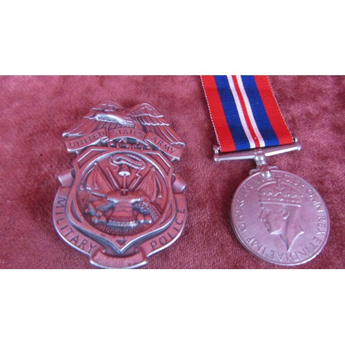57 - UNITED STATES ARMY POLICE BADGE AND A WWII MEDAL