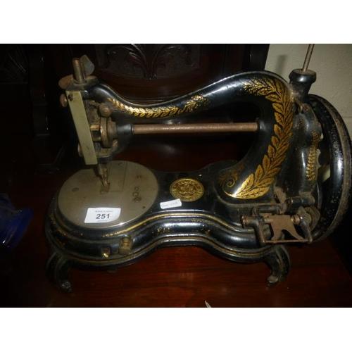 251 - ANTIQUE SEWING MACHINE...