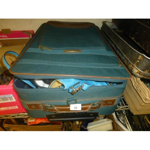 29 - SUITCASE AND CONTENTS...