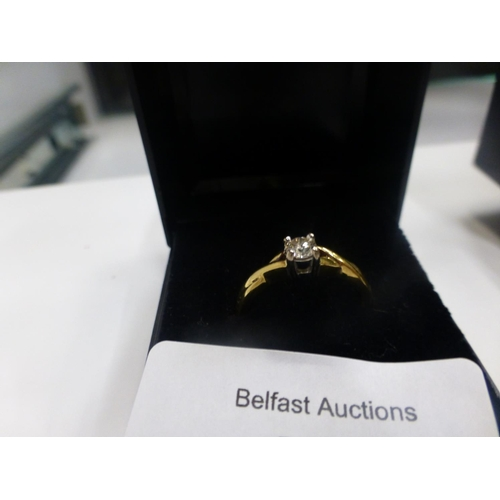 496 - 18CT GOLD AND DIAMOND RING...
