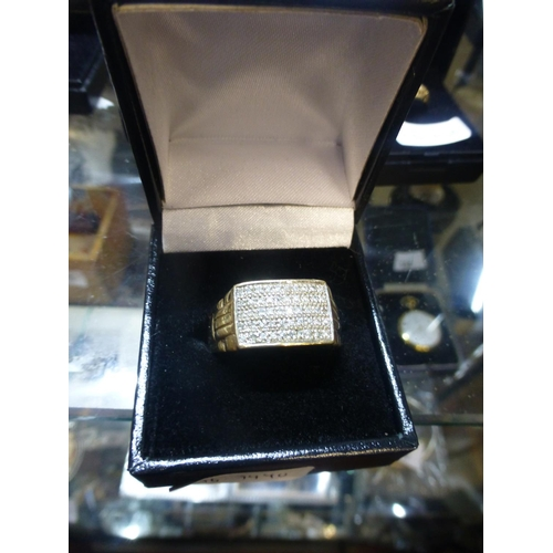 162 - 9CT GOLD AND DIAMOND RING...