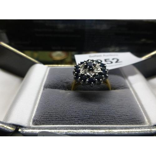 252 - 18CT SAPPHIRE AND DIAMOND RING...