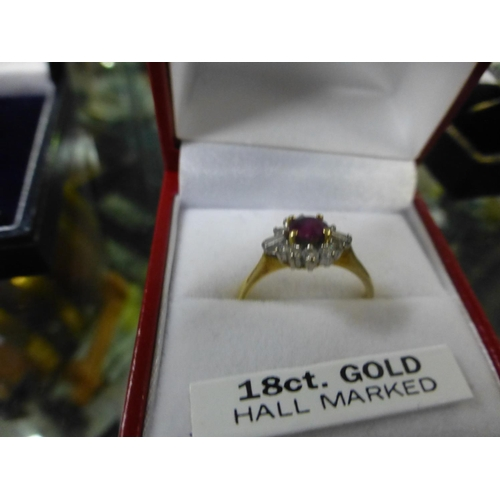 321 - 18CT RUBY, DIAMOND RING (N)...