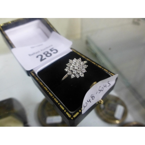 285 - 9CT WHITE GOLD DIAMOND CLUSTER RING (N)...